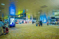 SINGAPORE, SINGAPORE - JANUARY 30, 2018: Close up of unidentified people walking and waiting in a lounge located at the. Enter of Singapore Changi Airport Royalty Free Stock Image