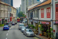SINGAPORE, SINGAPORE - JANUARY 30. 2018: Outdoor view of some cars circulating in a street and Urban scene in the. Central district of Singapore Royalty Free Stock Photos