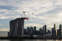Singapore, Singapore - Jun 30, 2018: Helicopters carrying Singapore Flag at Marina Bay in National Da royalty free stock photo