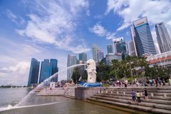 SINGAPORE, SINGAPORE - 31 MAY 2014 : The Merlion and Singapore c. Ity skyline at the marina bay in singapore, The Merlion statue is a symbol of Singapore city Royalty Free Stock Photo
