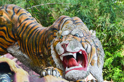 Singapore, Singapore - October 4, 2013Old Tiger Statue in the Haw Par Villa gardens Royalty Free Stock Images