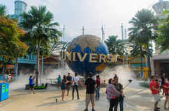 Singapore, Singapore - September 21, 2014:Tourists and the large rotating globe fountain in front of Universal Studios singapore stock image