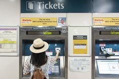 Buying ticket at train station royalty free stock image
