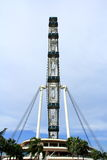 Singapore sky flyer stands on the platform. Singapore Flyer - the Largest Ferris Wheel in the World Stock Images