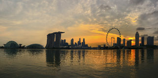 Singapore skyline. The Singapore skyline at nightfall from across the bay Royalty Free Stock Image