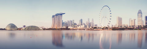 Singapore Skyline. Panoramic image of Singapore`s skyline at sunrise. (stiched from several images :Panoramic Royalty Free Stock Images