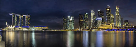 Singapore Skyline Along River Panorama. Singapore City Skyline with Highway Bridge Along Singapore River at Blue Hour Panorama Royalty Free Stock Images