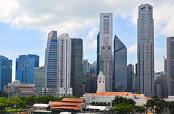 Singapore Skyline. The Singapore Skyline, consisting of the banking and financial district, with Victoria Concert Hall in the foreground Royalty Free Stock Photos