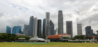 Singapore Skyline from Singapore Cricket Club. The city-state of Singapore has over 4,300 completed high-rises, the majority of which are located in the Downtown Stock Image
