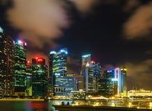 Singapore skyline of Downtown Core on Marina Bay at dusk Stock Photos