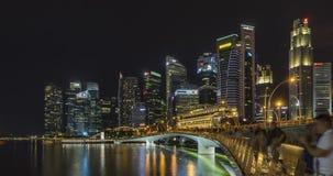 Singapore skyline dusk and illuminated financial district night. Time lapse, Singapore - April 14, 2017: Singapore skyline dusk and illuminated financial stock footage