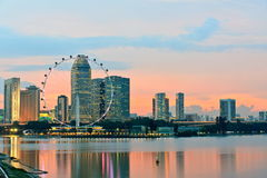 Singapore Skyline in the evening. Singapore flyer with skyscrapers and colorful sky at background, view from Marina Barrage at sunset time Royalty Free Stock Photo