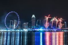 Singapore skyline and flyer at night with urban buildings and fi. Rework at night Royalty Free Stock Photos