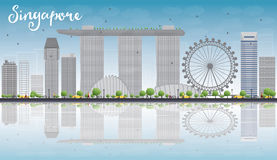 Singapore skyline with grey landmarks, blue sky and reflections Stock Photography