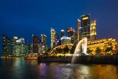 Singapore skyline, Marina bay and Merlion fountain view at dusk Stock Photos