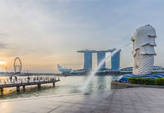 Singapore skyline and Merlion with sunrise Stock Image