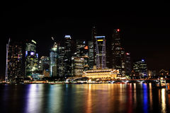The Singapore skyline at night. From across the bay Stock Image