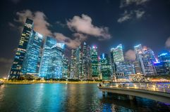Singapore Skyline at Night from Marina Bay. Office buildings, skyscrapers cityscape in Singapore central business district skyline, blue sky and night skyline Royalty Free Stock Photo