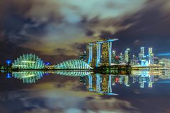 Singapore skyline at night with urban buildings with beautiful r. Eflexion Stock Images