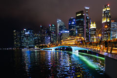 Singapore skyline at night. Night view from Marina Bay of skyline with big, illuminated skyscapers  and bridge, downtown, Singapore Royalty Free Stock Images