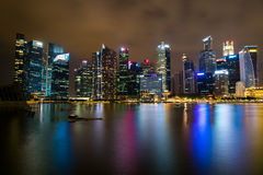 Singapore skyline at night. View of Singapore skyline and Marina bay at night with reflection in water Royalty Free Stock Photo