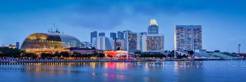 Singapore skyline panorama at Marina Bay. Panorama of Singapore skyline at Marina Bay in the evening Stock Images