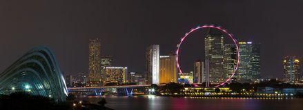 Singapore skyline panorama at night. Panorama from the Marina Barrage in 2012, showing the nearly completed Garden by the Bay, the Marina Bay reservoir and the Stock Photography