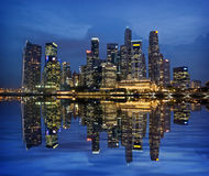 Singapore Skyline Reflected on Marina Bay  Royalty Free Stock Photography