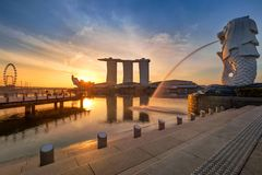 Singapore Skyline. Singapore`s business district, famous Merlion. On sunrise time with real sun royalty free stock photography