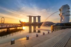 Singapore Skyline. Singapore`s business district, famous Merlion on sunrise. Time with real sun royalty free stock images