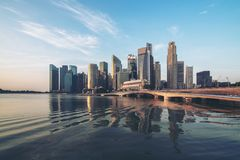 Singapore skyline at sunrise at Marina Bay Stock Photos