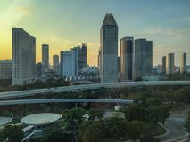 Singapore skyscrapers at sunset. From a flyer cabin on the hight of birds. Wonderful reach colors, beautiful buildings, amazing view. Yellow, golden and blue stock photos