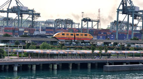 Singapore Skytrain. Passing the shipping port to Sentosa Island Stock Photo