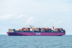 One Aquila container ship of Ocean Network Express company sails in the Singapore strait stock images
