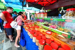 Singapore : Street food. Street vendor outside Sultan Mosque Singapore ,preparing food for customer at a bazar during ramadan month. Sultan Mosque; is located at royalty free stock photography