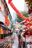 Singapore street market with red lanterns and local asian people royalty free stock photo