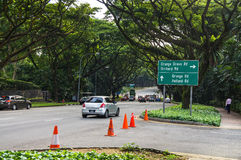 Singapore street. `orchard boulevard`, drowning in greenery. Showing the wide boulevard like street scene with modern cars, taxis, Road sign Stock Photography