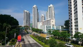 Singapore Street Scene. A view down Singapores Farrer Road from the walkway overpass at Farrer Road MRT station. Image shows a typical Singapore street scene Royalty Free Stock Photos