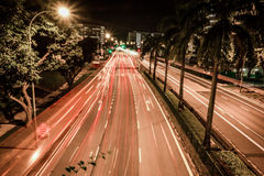 Singapore streets traffic. Singapore urban street night traffic movements Royalty Free Stock Photography