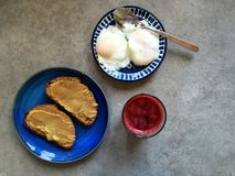 Singapore-style breakfast at home: kaya toast, poached eggs, beet juice Stock Photo