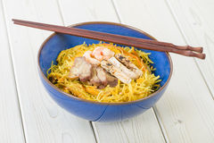 Singapore-Style Noodles. Stir-fried rice vermicelli seasoned with curry powder, beansprouts, pak choi, soy sauce, and chilli peppers. Topped with slices of royalty free stock photos