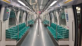 Singapore Subway Train. Interior view of an empty subway train car running on the Singapore MRT system. The image was shot using the camera on a mobile phone Royalty Free Stock Photos