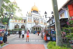 Singapore:Sultan Singapura Mosque. Tourist and crowd taking picture out the compound of Sultan mosque . Outside the mosque street vendor selling street food Royalty Free Stock Image