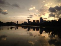 Singapore Sunset view from Kallang near New Stadium. Tranquil river view with Singapore Flyer visible in the distance Royalty Free Stock Image