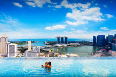 Singapore. Swimming pool on roof top with beautiful city view, Singapore Stock Photo