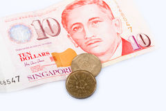 Singapore ten dollar banknote and coins Stock Images