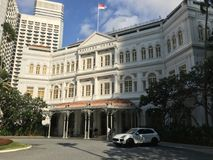 Luxury car in front of Raffles Hotel, Singapore royalty free stock photo