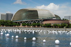 Singapore: Theatres on the Esplanade. The Theatres on the Esplanade, known as the Durians, viewed across the Singapore River strewn with floating white buoys in Royalty Free Stock Images