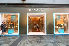 Singapore: Tiffany & Co. Tiffany & Co retail store at MBS. Crowd walking past royalty free stock photography