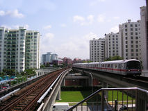 Singapore train. The commuter train in Singapore, apartment buildings in the background Stock Image